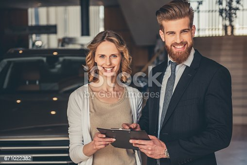 671035278istockphoto Visiting car dealership 671022382