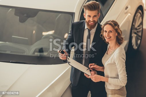 671035278istockphoto Visiting car dealership 671024216
