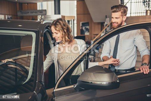 671035278istockphoto Visiting car dealership 671024964