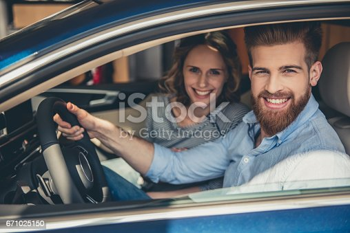 664521270 istock photo Visiting car dealership 671025150
