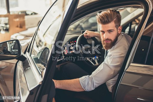 671035278istockphoto Visiting car dealership 671025458