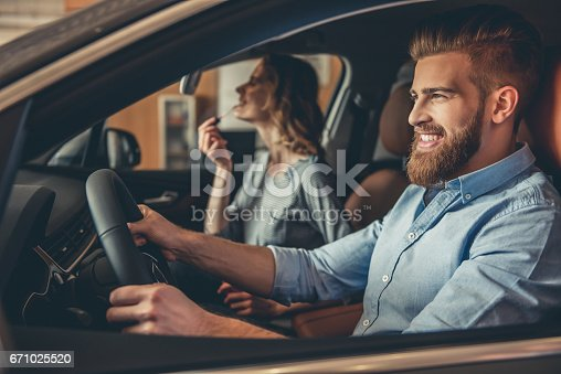 664521270 istock photo Visiting car dealership 671025520