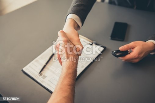 istock Visiting car dealership 671028694
