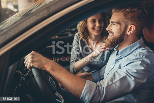 671035278istockphoto Visiting car dealership 671031910