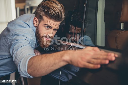 671035278istockphoto Visiting car dealership 671031976