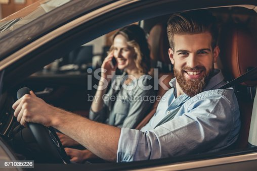 671035278istockphoto Visiting car dealership 671035226