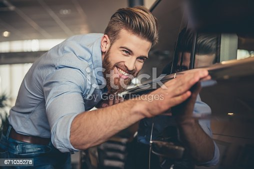 istock Visiting car dealership 671035278