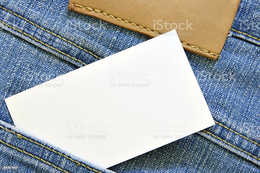 Visiting card in jeans pocket royalty-free stock photo