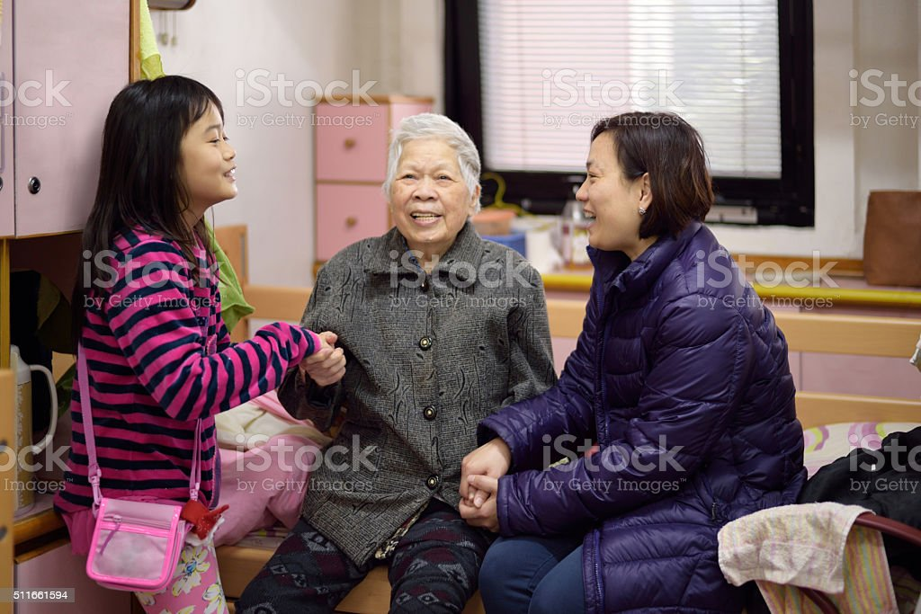 visiting grandma stock photo