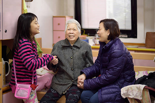 visiting grandma stock photo