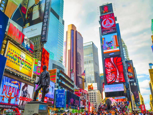 visiting new-york on the east coast of usa - times square stock photos and pictures