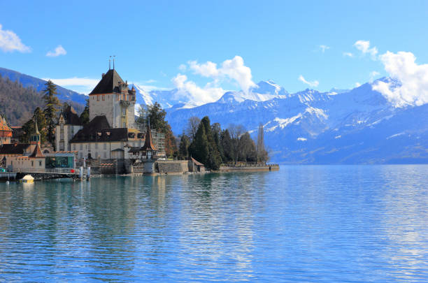 Visiting Oberhofen Castle on a sunny morning in March. Oberhofen town is located on the northern shore of Lake Thun. stock photo