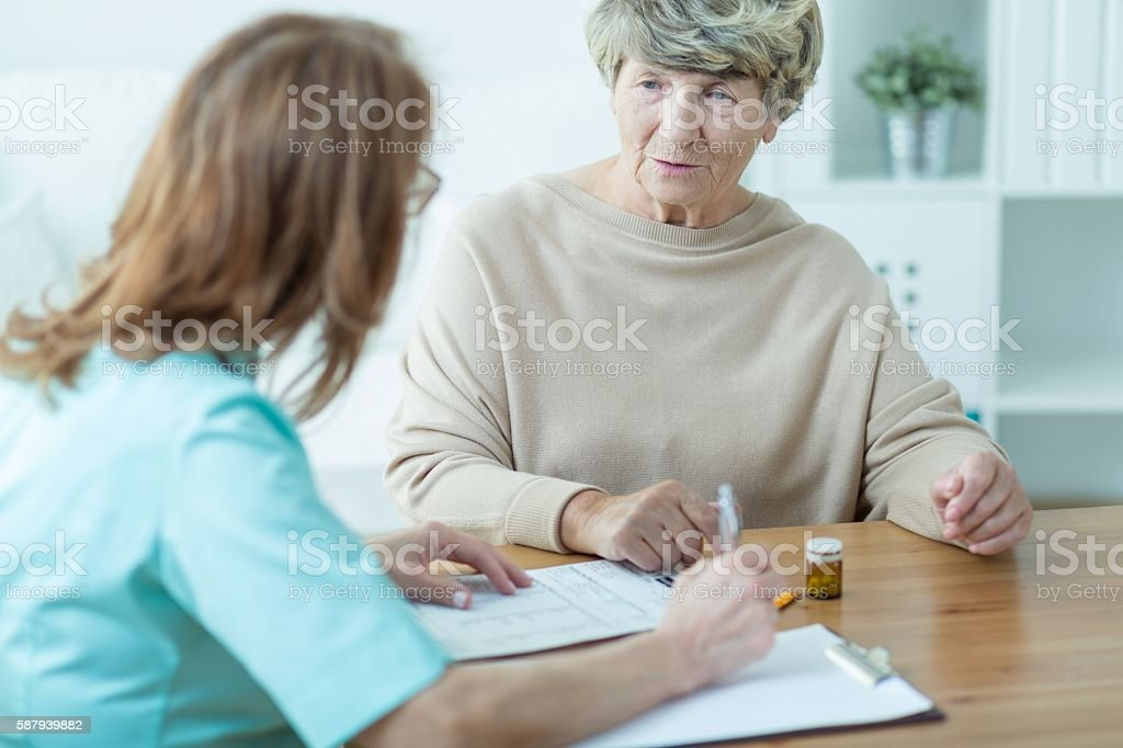 Visiting old patient stock photo