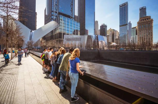 Visiting the National September 11 Memorial in New York City stock photo