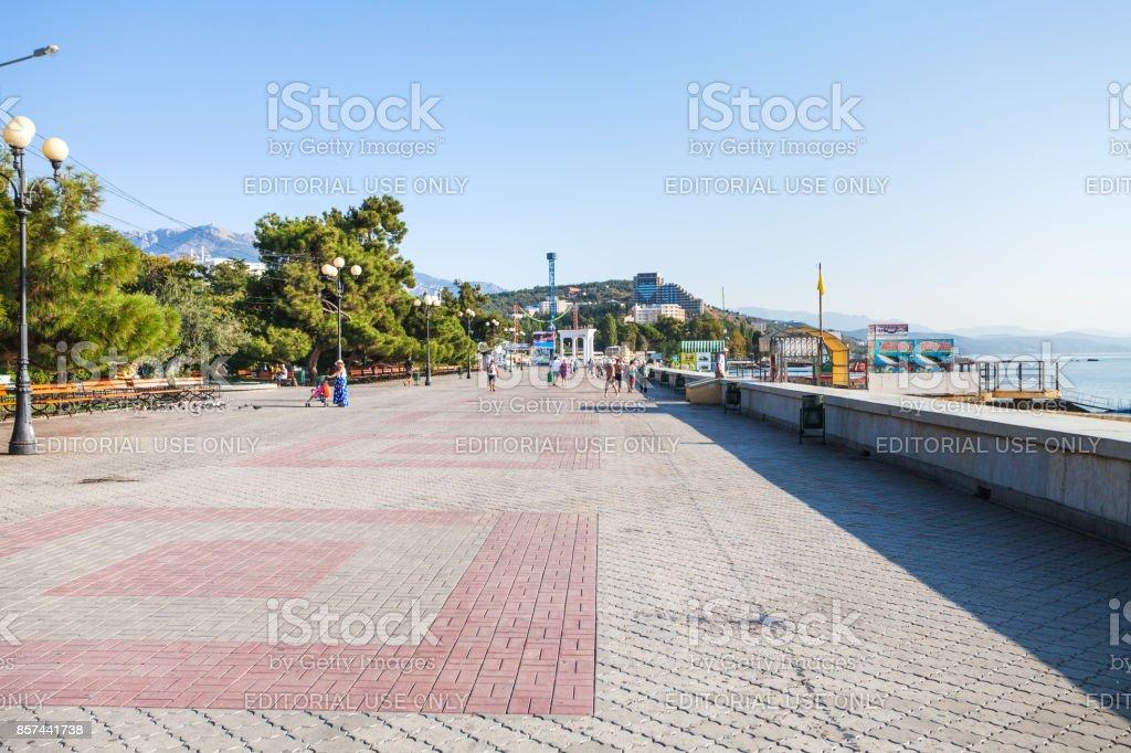 visitor on Lenin Street Embankment in Alushta city stock photo