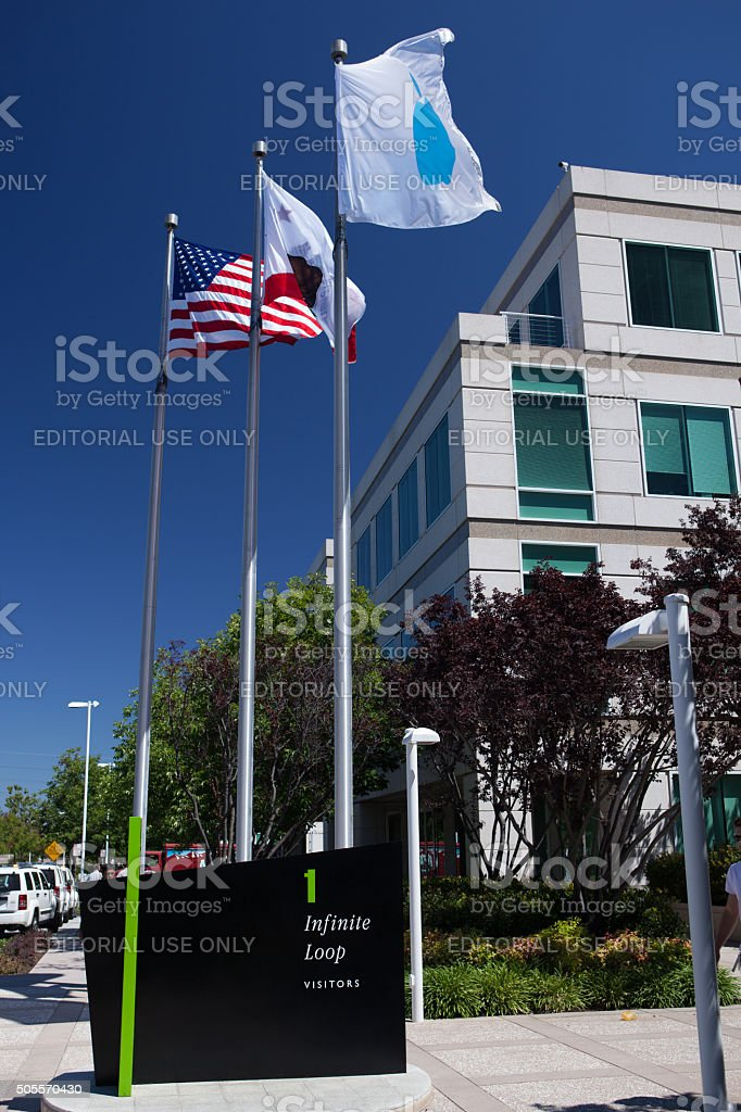 Visitor welcome sign and flags at Apple, Inc. headquarters stock photo