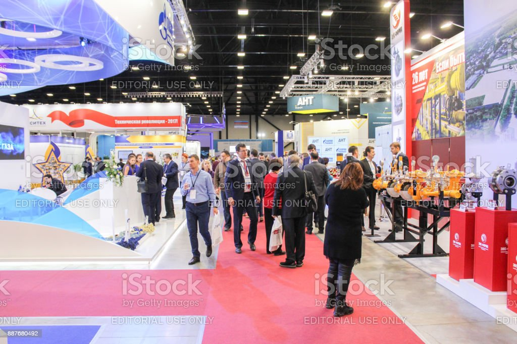 Visitors among the stands of companies. stock photo