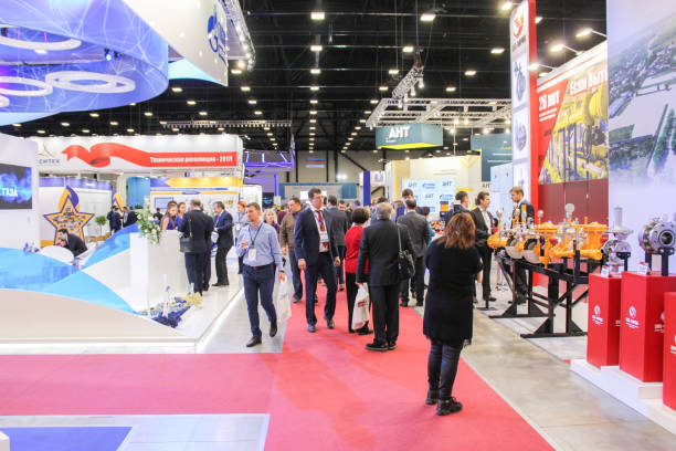 Visitors among the stands of companies. St. Petersburg, Russia - 4 October, 2017. conference event stock pictures, royalty-free photos & images
