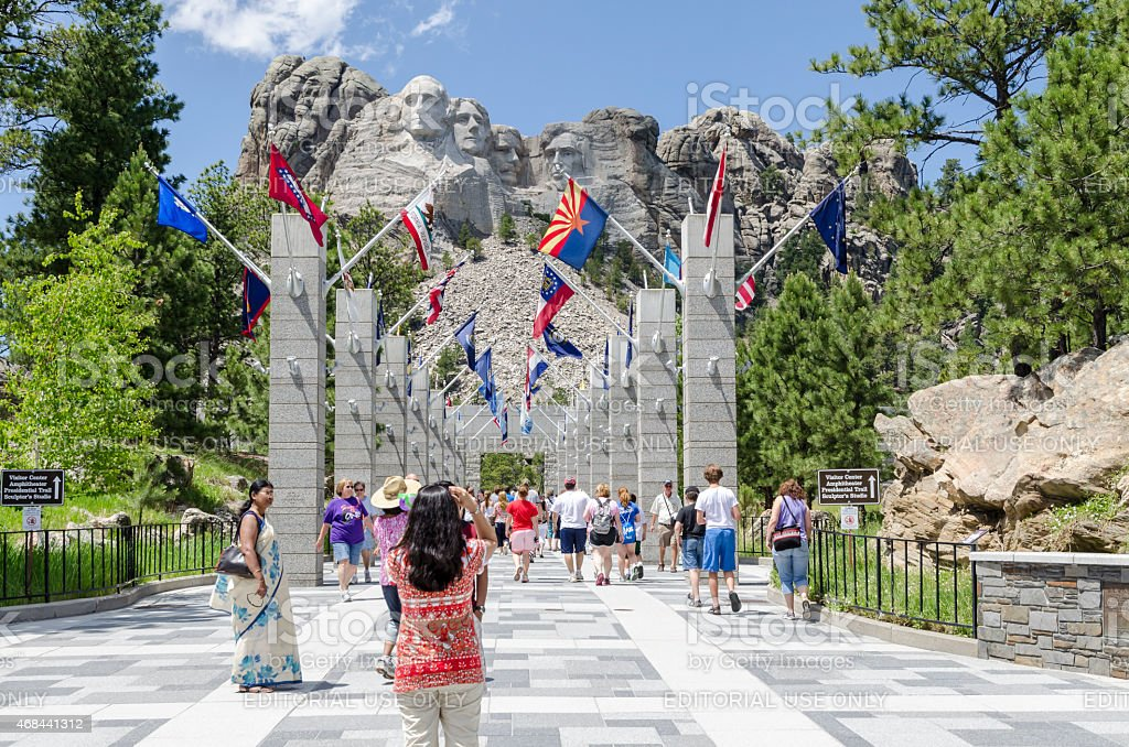 Visitors at Mount Rushmore Avenue of Flags. stock photo