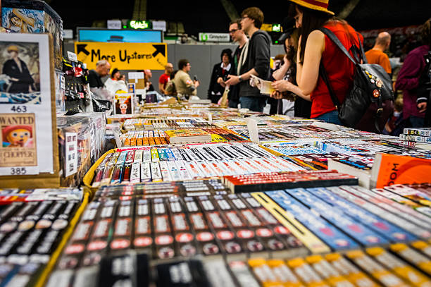 visitors browse a stall at yorkshire cosplay convention - manga style stock photos and pictures