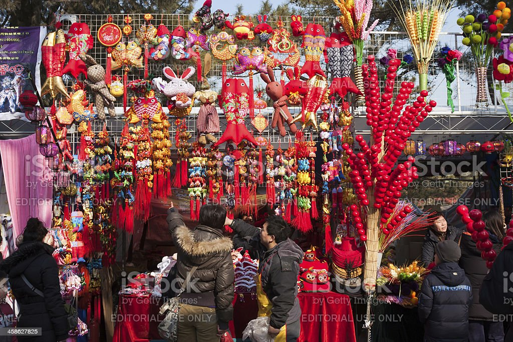 Visitors buy goods during the Spring Festival Temple Fair,Beijing stock photo
