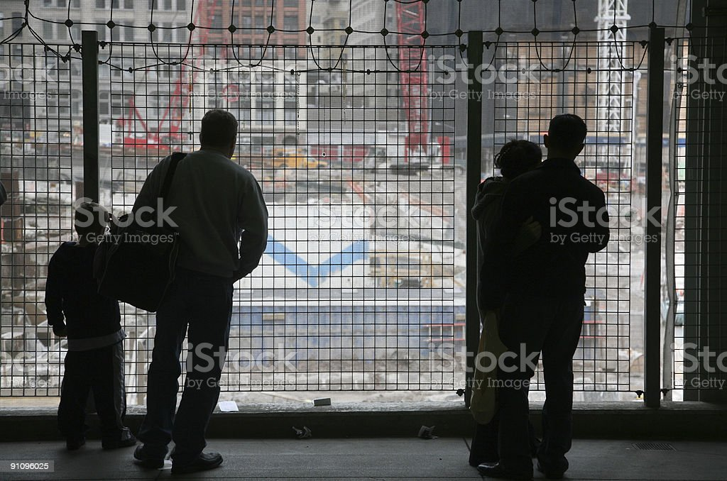 Visitors Contemplating At Ground Zero Site royalty-free stock photo