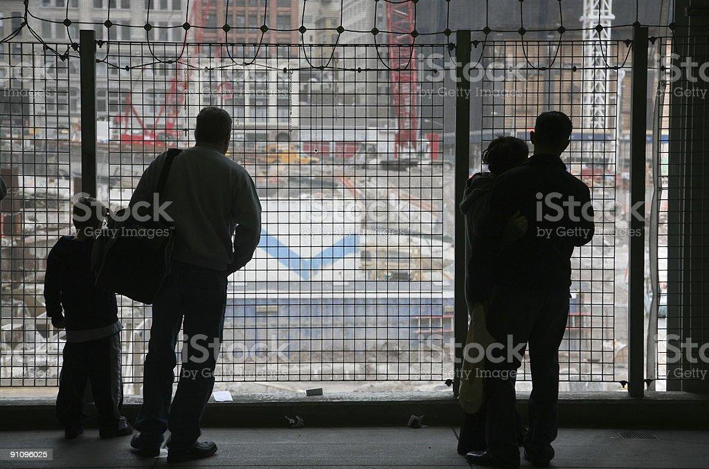 Visitors Contemplating At Ground Zero Site stock photo