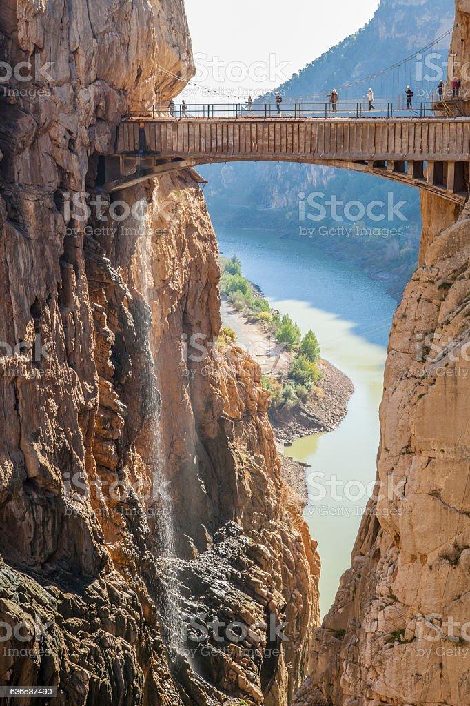 Visitors crossing the suspension bridge at Caminito del Rey Path stock photo