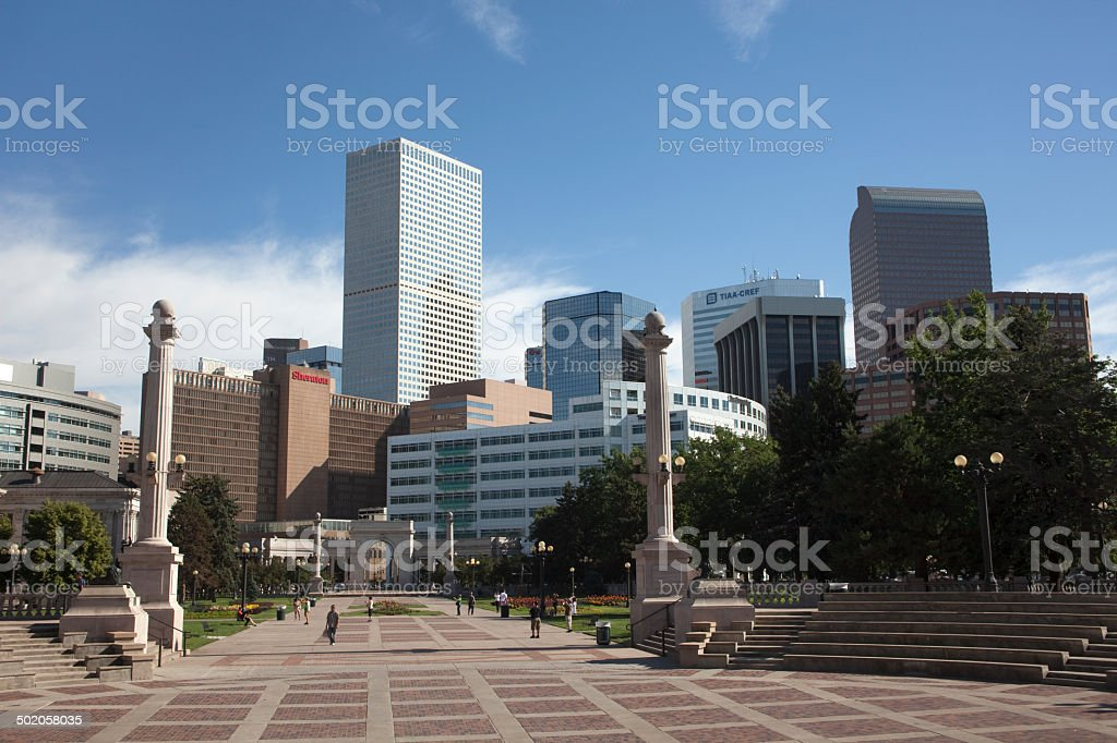 Visitors enjoy Downtown Denver in Civic Center Park stock photo