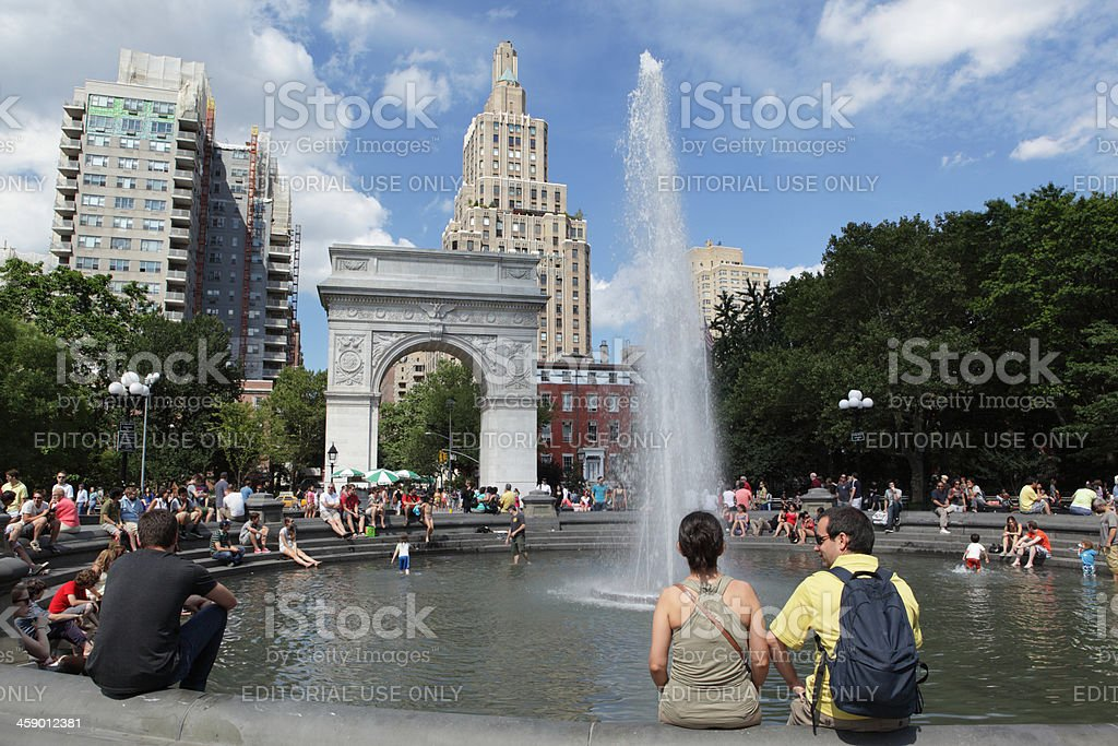 Visitors enjoying fountain in Washington Square Park NYC stock photo