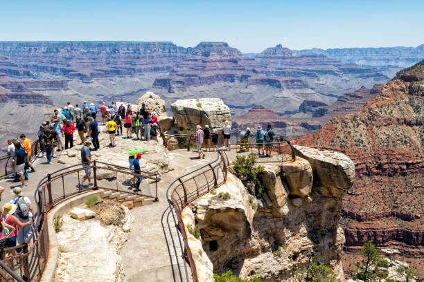 Visitors Enjoying Views of Grand Canyon National Park, Arizona, USA stock photo
