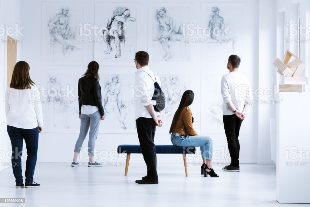 Visitors in art gallery stock photo