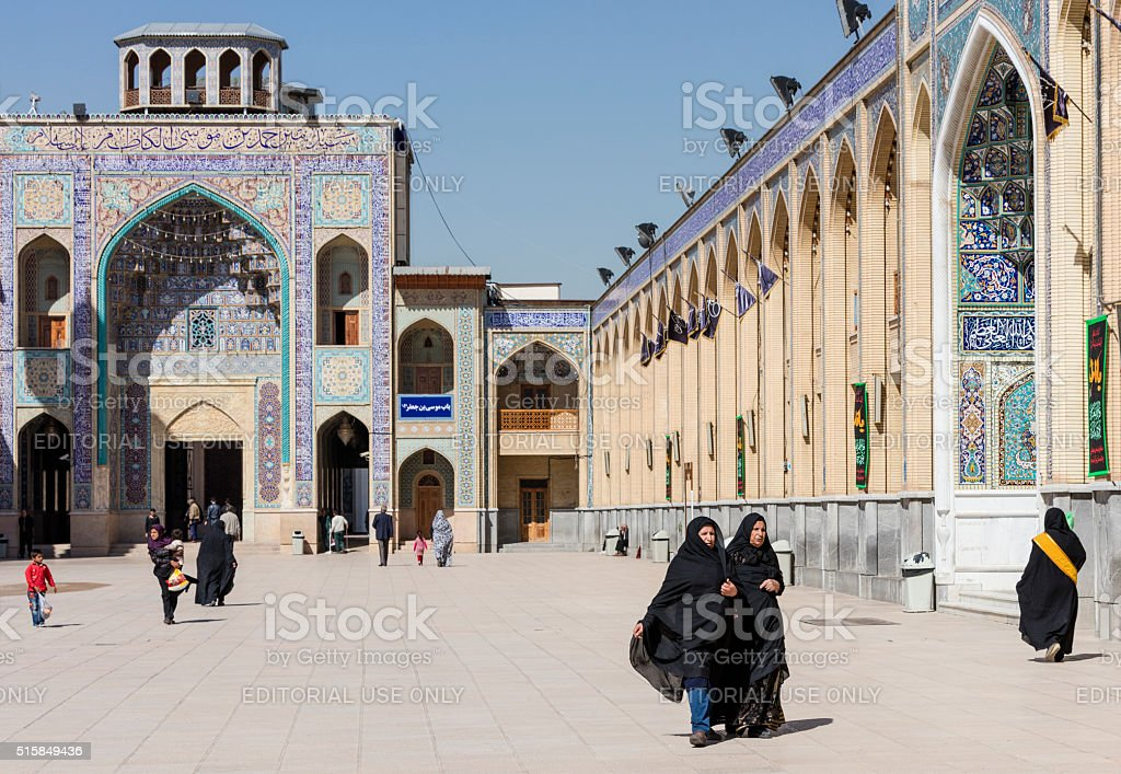 Visitors in forecourt of Shah Cheragh Mausoleum, Shiraz, Iran stock photo