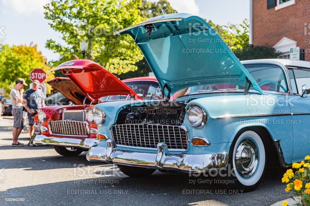 Visitors inspect classic cars on display at the Matthews Auto Reunion stock photo