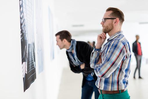 Visitors Looking At Artwork