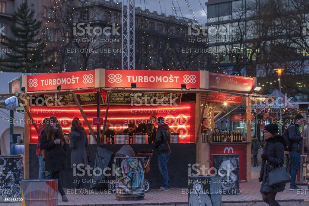 Visitors of drink bar at Christmas market stock photo
