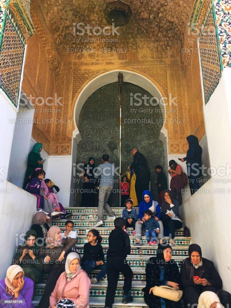 Visiteurs de la mosquée de Sidi Boumediene - Photo