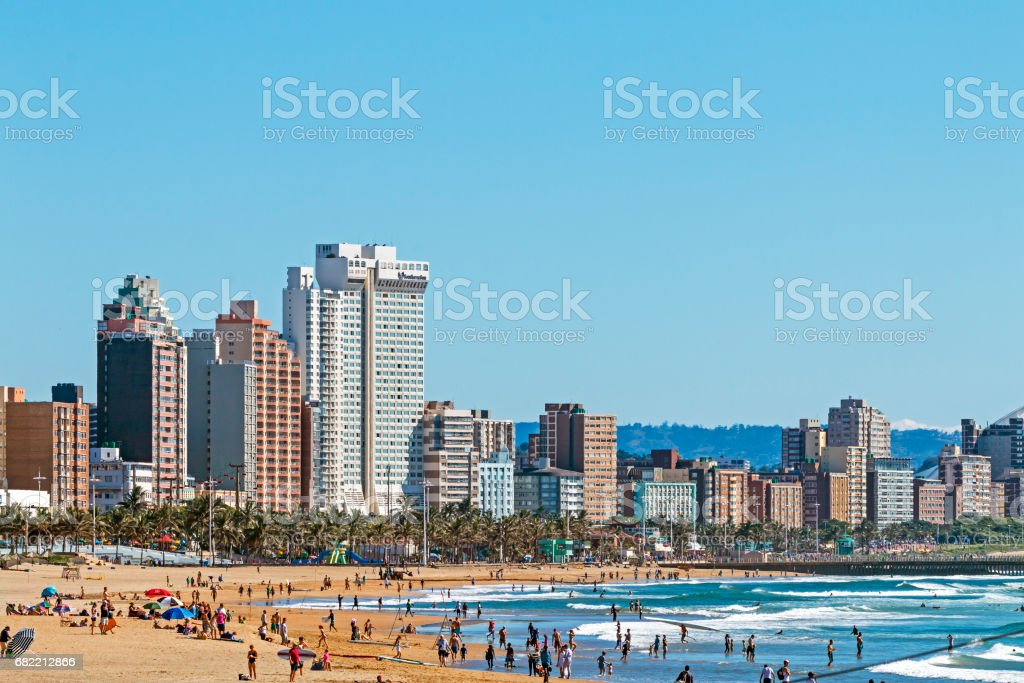 Visitors on beach Agaist City Skyline in Durban stock photo