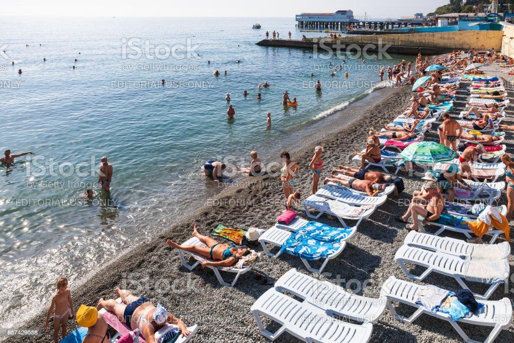 visitors on coast of Black Sea in Alushta city stock photo
