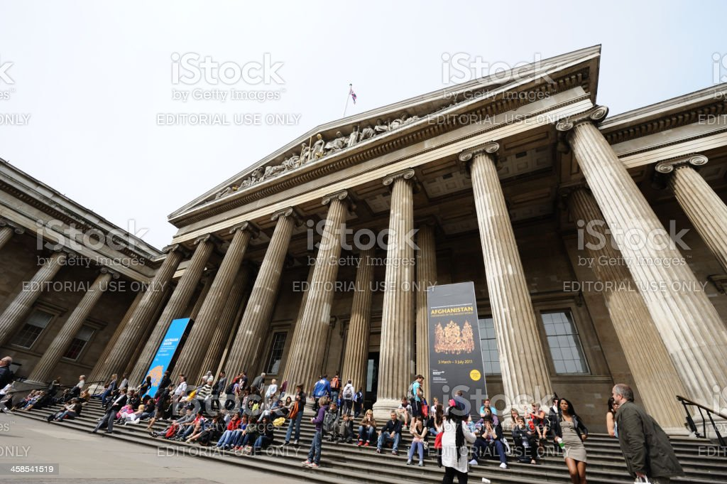 Visitors sitting on the stairs of British Museum stock photo