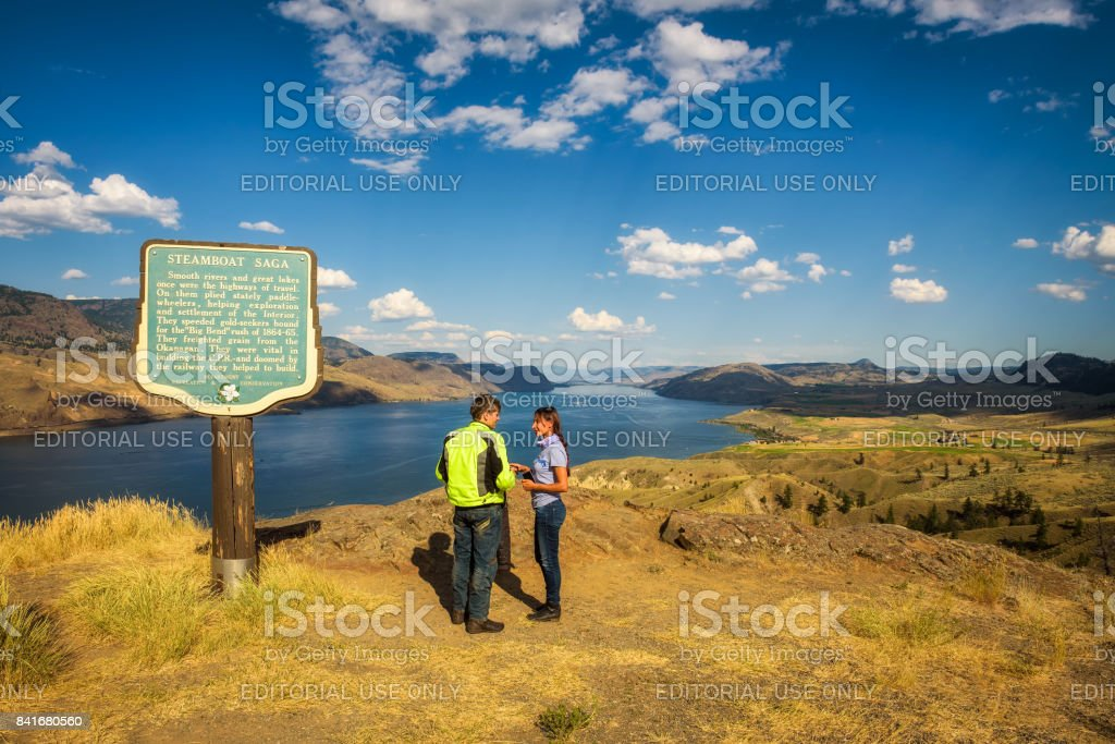 Visitors standing at the Kamloops lake in Canada stock photo
