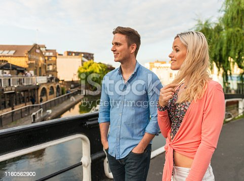 Visitors on a bridge over Regent's Canal in Camden.