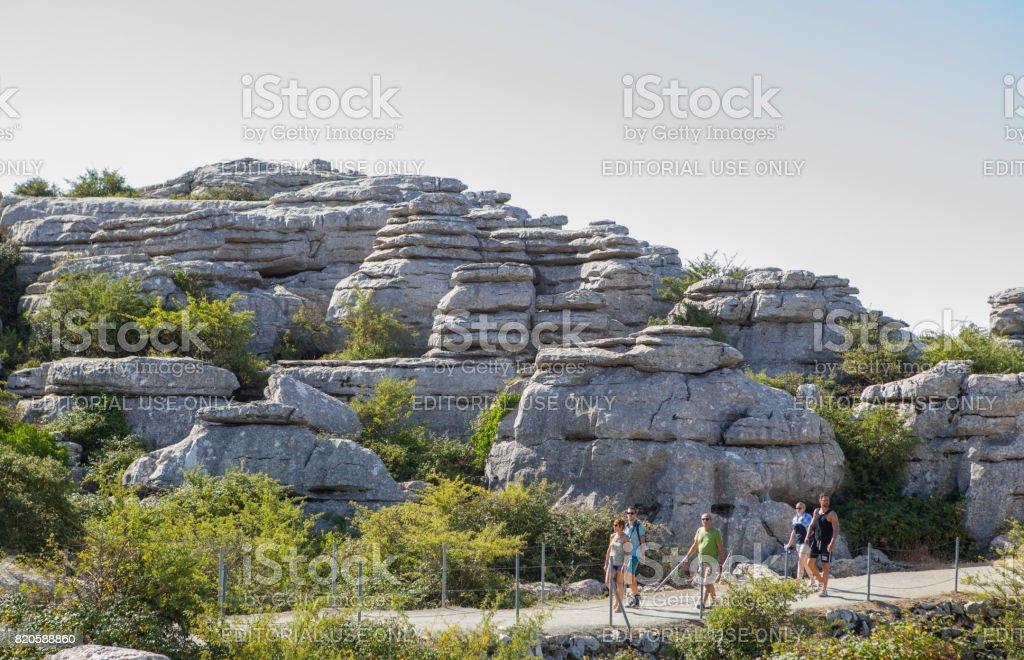 Visitors walking by Torcal Natural Park trail, Malaga, Spain stock photo