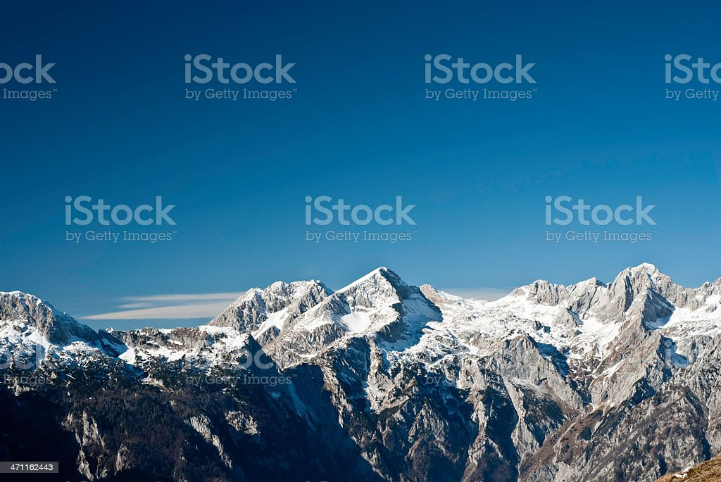 Vista photo of the Alps' snow covered peaks royalty-free stock photo