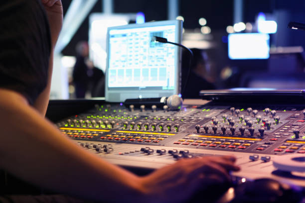 visual and audio mixers for montage and production at live events close ups on sound engineer with studio sound and visual mixer used for media and events directing and recording studios performing arts event stock pictures, royalty-free photos & images