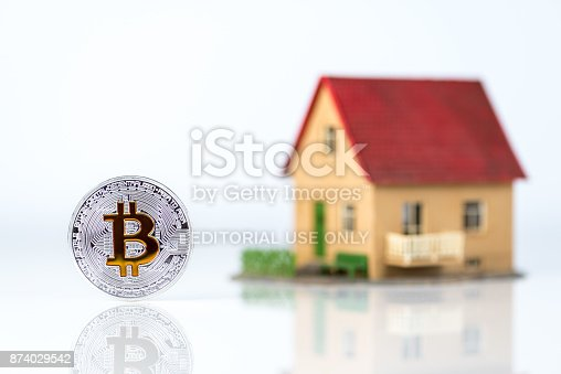626187670istockphoto Visual representation of Bitcoin and real estate market 874029542