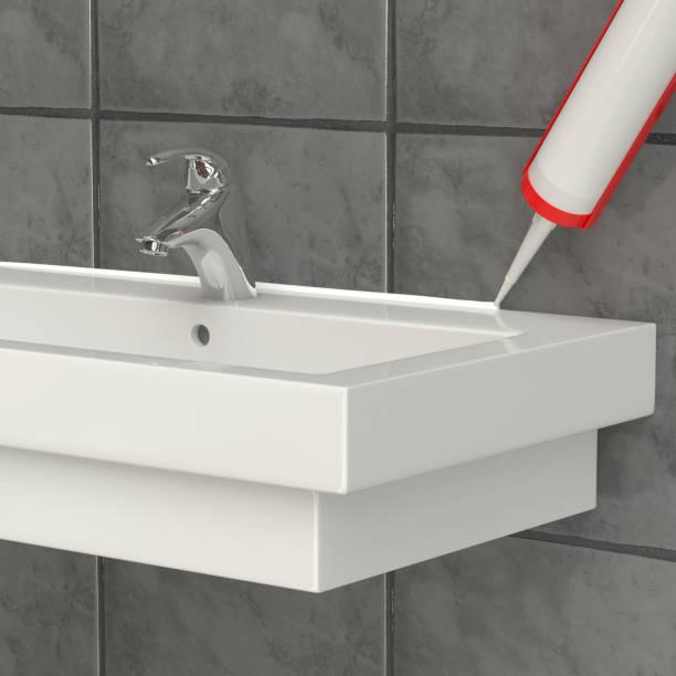 visualization. the sealant is applied to the washbasin - silicone foto e immagini stock