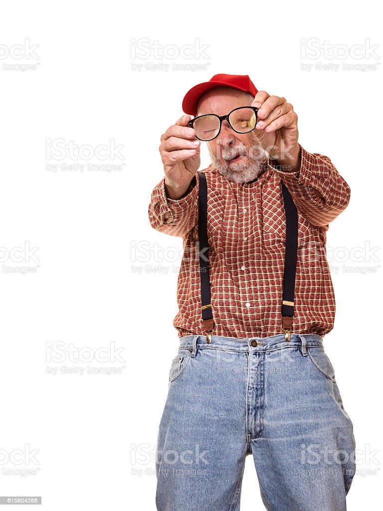 08762a1d9 Visually Impaired Redneck Red Hat Suspenders Hillbilly Man Examining  Eyeglasses foto de stock royalty-free