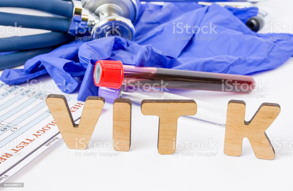 Vit K vitamin K acronym or abbreviation diagnostics or medical laboratory test photo concept. Word Vit K is background of blood sample in test tube, protective gloves and hematological blood analysis stock photo