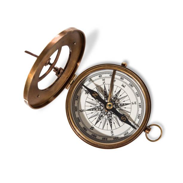 vitage mässing kompass med solen-ratten. - ancient white background bildbanksfoton och bilder